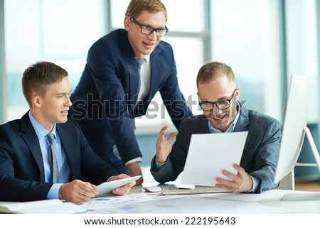 Businessman presenting results to his colleagues - stock photo