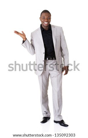 Businessman presenting something on his palm, isolated on white - stock photo