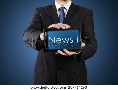 businessman presenting something on tablet - News ! - stock photo