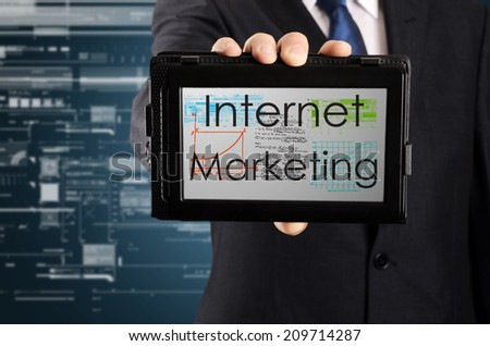 businessman presenting something on tablet with business or technology background - Internet marketing - stock photo