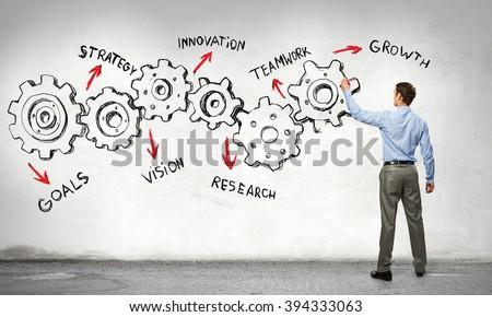 Businessman presenting teamwork concept - stock photo
