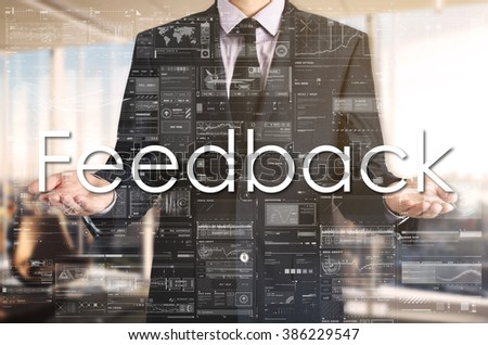 Businessman presenting text Feedback on virtual screen. He is in the office - stock photo