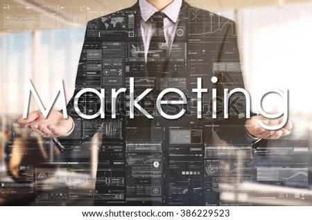 Businessman presenting text Marketing on virtual screen. He is in the office - stock photo