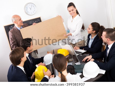 Businessman presents new development plan at poster in the office - stock photo