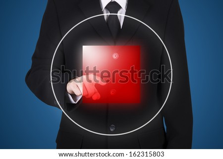 businessman press on stop button, blue background - stock photo