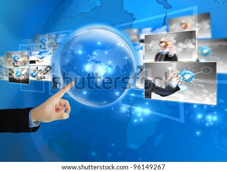 Businessman press world .Technology concept - stock photo