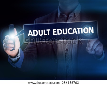 Businessman presses button adult education on virtual screens. Business, technology, internet and networking concept. - stock photo