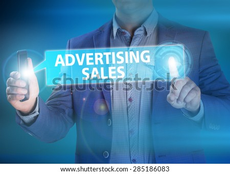 Businessman presses button advertising sales on virtual screens. Business, technology, internet and networking concept. - stock photo