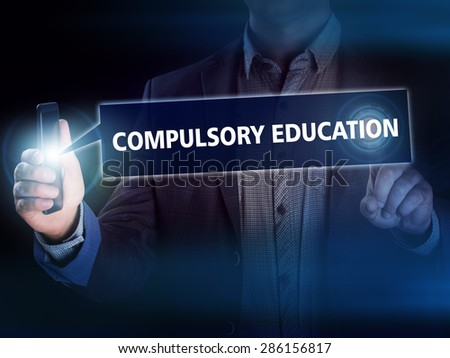 Businessman presses button compulsory education on virtual screens. Business, technology, internet and networking concept. - stock photo