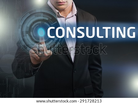 Businessman presses button consulting on virtual screens. Business, technology, internet and networking concept. - stock photo