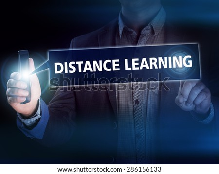 Businessman presses button distance learning on virtual screens. Business, technology, internet and networking concept. - stock photo