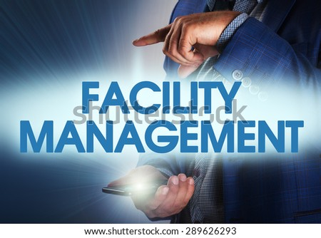 Businessman presses button facility management on virtual screens. Business, technology, internet and networking concept. - stock photo