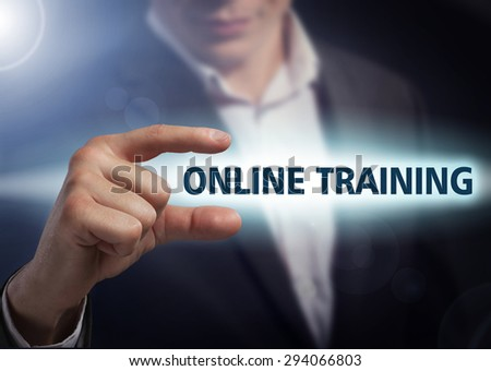 Businessman presses button online training on virtual screens. Business, technology, internet and networking concept. - stock photo