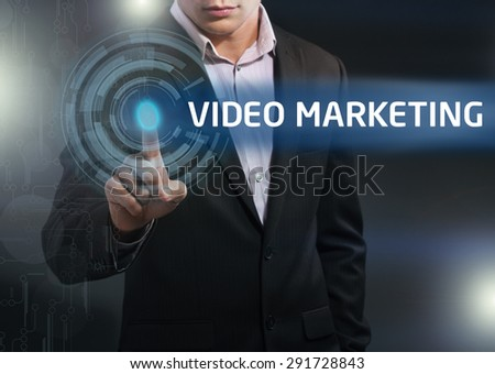 Businessman presses button video marketing on virtual screens. Business, technology, internet and networking concept. - stock photo