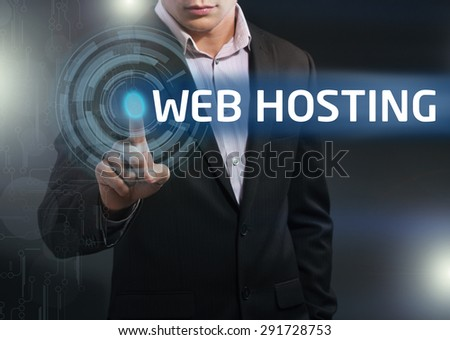 Businessman presses button web hosting on virtual screens. Business, technology, internet and networking concept. - stock photo