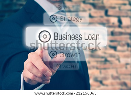 Businessman pressing a Business Loan concept button. Instagram styling applied. - stock photo