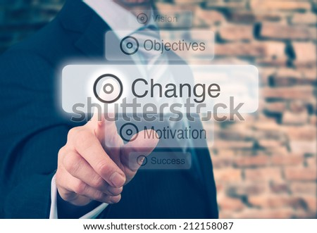 Businessman pressing a Change concept button. Instagram styling applied. - stock photo