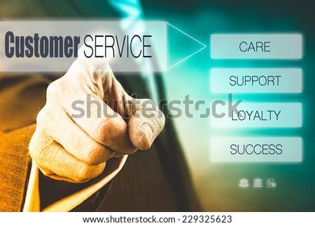 Businessman pressing a Customer Service Concept button. - stock photo