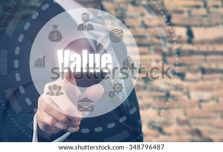 Businessman pressing a Value concept button. - stock photo