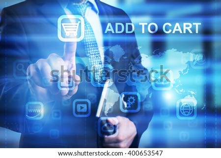 Businessman pressing add to cart icon on virtual screen . - stock photo