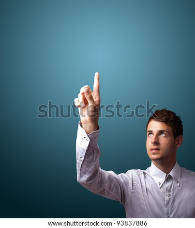 Businessman pressing an imaginary button on bokeh - stock photo