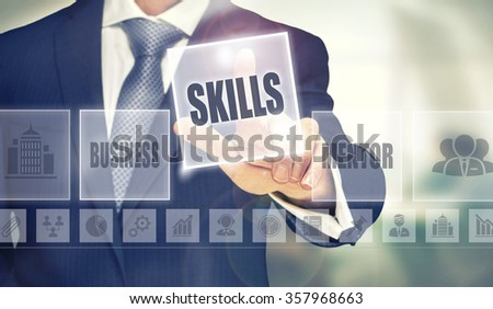 Businessman pressing an Skills concept button. - stock photo