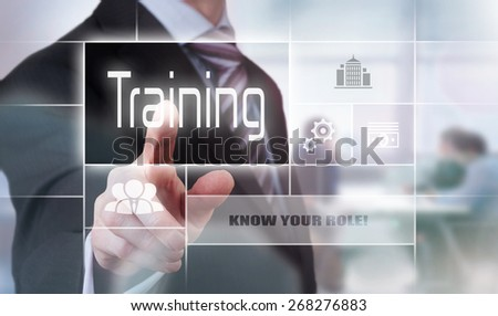 Businessman pressing an Training concept button. - stock photo
