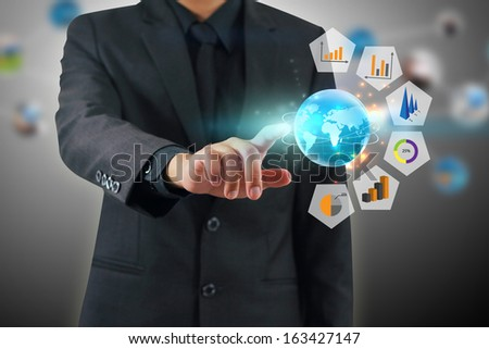 Businessman pressing business graph - stock photo