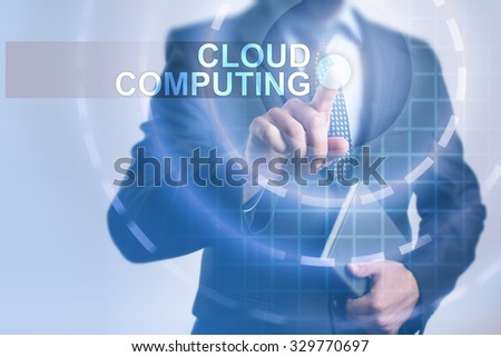 Businessman pressing button on touch screen interface and select Cloud computing. Business, internet, technology concept. - stock photo
