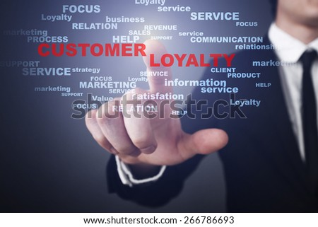 Businessman pressing button on touch screen interface and select customer loyalty. Business concept. - stock photo
