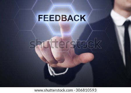 "Businessman pressing button on touch screen interface and select ""Feedback"". Business concept. Internet concept. - stock photo"