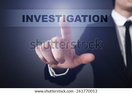 Businessman pressing button on touch screen interface and select  investigation. Business concept. - stock photo