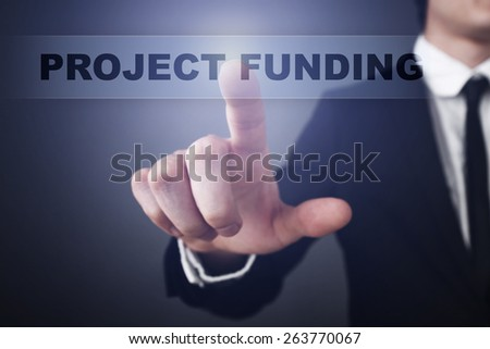 Businessman pressing button on touch screen interface and select  project funding. Business concept. - stock photo