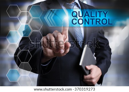 """Businessman pressing button on touch screen interface and select """"Quality control"""". Business concept. Internet concept. - stock photo"""