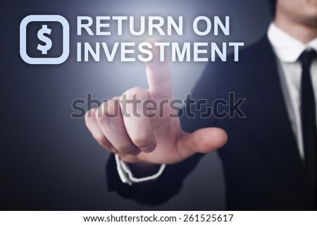Businessman pressing button on touch screen interface and select return on investment.   business concept. - stock photo