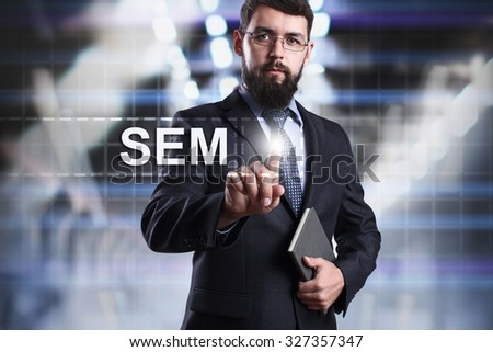 Businessman pressing button on touch screen interface and select SEM. Business concept. Internet concept. - stock photo