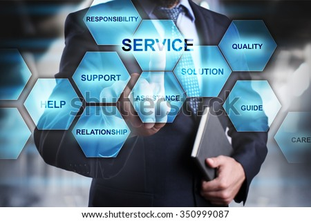 Businessman pressing button on touch screen interface and select service. busines concept.   - stock photo