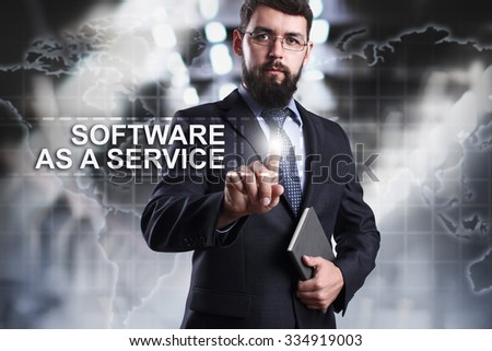 Businessman pressing button on touch screen interface and select Software as a service. Business concept. Internet concept. - stock photo