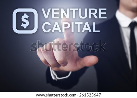 Businessman pressing button on touch screen interface and select venture capital   business concept. - stock photo