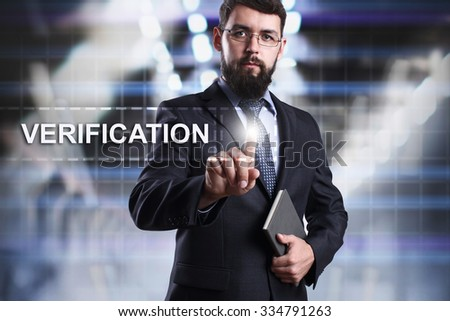 Businessman pressing button on touch screen interface and select Verification. Business concept. Internet concept. - stock photo