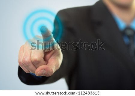 Businessman pressing button on touch screen technology - stock photo