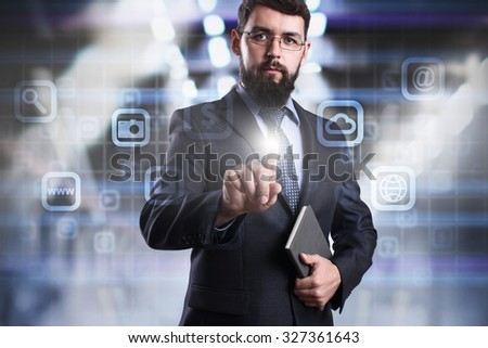 Businessman pressing button on virtual screen. Business, internet and technology concept. - stock photo