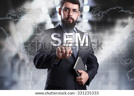 Businessman pressing button SEM on the virtual screen. Business, internet and technology concept. - stock photo