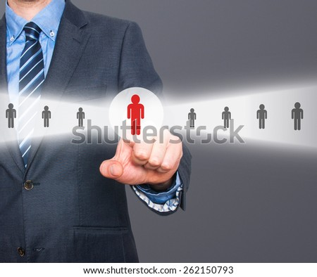 Businessman pressing button.Technology, internet, networking and recruitment concept. Isolated on grey background. Stock Photo  - stock photo