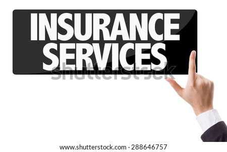 Businessman pressing button with the text: Insurance Services - stock photo