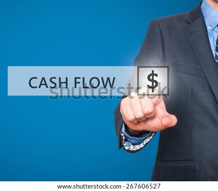 Businessman pressing Cash Flow button on virtual screens. $ icon. Isolated on blue. Business, technology and internet concept - Stock Image - stock photo