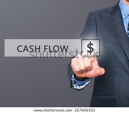 Businessman pressing Cash Flow button on virtual screens. $ icon. Isolated on grey. Business, technology and internet concept - Stock Image - stock photo