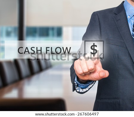 Businessman pressing Cash Flow button on virtual screens. $ icon. Isolated on office. Business, technology and internet concept - Stock Image - stock photo
