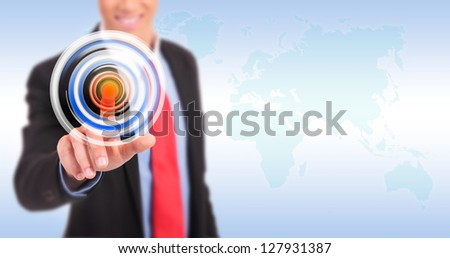 Businessman pressing circle button on a virtual background - stock photo