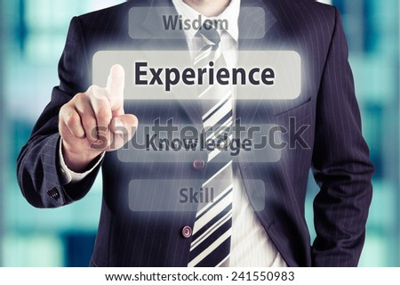 Businessman pressing experience button. Experience concept, toned photo. - stock photo